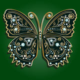 Glamour vector vintage golden butterfly. With elegance ornament encrusted with blue jewels on dark green background. with shadow Stock Image