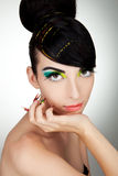 Glamour woman. Beautiful face of a glamour woman with modern curly hairstyle, brightly makeup and big nails Royalty Free Stock Images