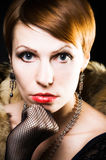 Glamour woman. Glamour girl in a retro style against a dark background Royalty Free Stock Photo