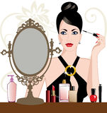 Glamour woman applying makeup Stock Photos