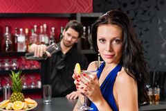 Glamour woman at bar holding cocktail Royalty Free Stock Photos