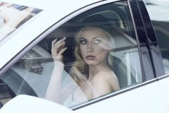 Glamour woman in a car stock photography