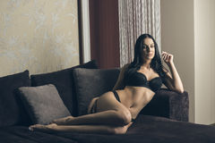 Glamour woman on couch Royalty Free Stock Images
