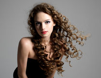 Glamour woman with curly long hair stock photos