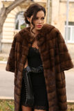 Glamour woman with dark hair wearing luxurious fur coat royalty free stock photo