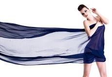 Glamour woman dressing on chiffon Stock Photography