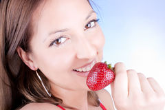 Glamour woman eating fresh strawberry Royalty Free Stock Photos