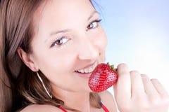 Glamour Woman Eating Fresh Strawberry Royalty Free Stock Photos