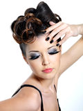 Glamour woman with fashion eye make-up. And black nails on white background stock photography