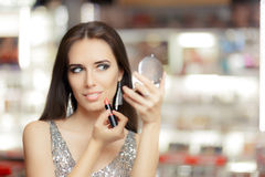 Glamour Woman with Lipstick and Make-up mirror Royalty Free Stock Photography