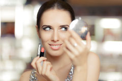Glamour Woman with Lipstick and Make-up mirror Royalty Free Stock Images