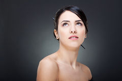 Glamour woman looking up. Beautiful face of a glamour woman with modern hairstyle and brightly makeup looking up Stock Photo