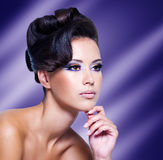 Glamour woman with modern curly hairstyle Stock Image