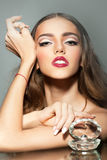 Glamour woman with pearl shell Royalty Free Stock Image