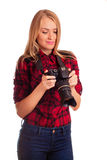 Glamour woman photographer looking unhappy at the screen of her Royalty Free Stock Image