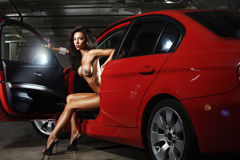 Glamour woman in a red car Royalty Free Stock Photo