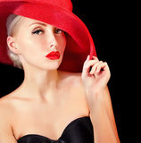 Glamour woman in red hat with red lips Royalty Free Stock Photos