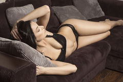 Glamour woman relaxed on couch Royalty Free Stock Photography