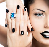 Glamour woman's nails , lips and eyes painted color black. Royalty Free Stock Photo