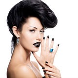 Glamour woman's nails , lips and eyes painted color black. Stock Photography