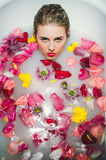 Glamour woman with silk skin having bath in rose petals Stock Images