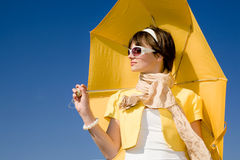Glamour woman under yellow umbrella Royalty Free Stock Images