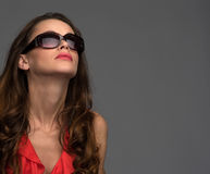 Glamour woman wearing a sunglasses and looking up Stock Images