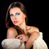 Glamour woman in white fur on black background Royalty Free Stock Photos