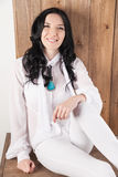 Glamour woman in white shirt and pants posing Royalty Free Stock Photo