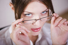 Glamour at Work. Beautiful Working woman in glasses Royalty Free Stock Images