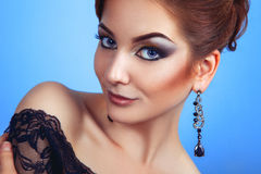 Glamour young adult person with make up on blue background Stock Photo