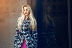 Glamour young blonde woman with blue eyes looking at the camera Royalty Free Stock Image