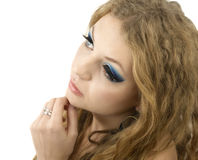 Glamour young woman with blue eye make-up and curly hairstyle on Stock Photography