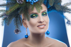 Glamour young woman with nice makeup and christmas tree-wreath o Royalty Free Stock Photography