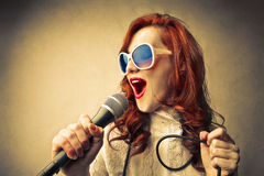 Glamour young woman singing Stock Image