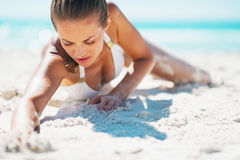 Glamour young woman in swimsuit laying on beach Royalty Free Stock Images