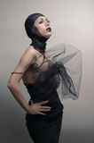 Glamoure gothic woman in black dress stock image