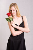 Glamouros young blond with rose. Stock Photos