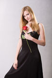 Glamouros young blond with rose. Royalty Free Stock Photos