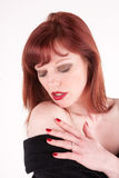 Glamourous. An attractive woman checking her skin Royalty Free Stock Image