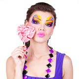 Glamourous beautiful woman holding lollipop Royalty Free Stock Photos