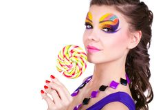 Glamourous beautiful woman holding lollipop Stock Photos