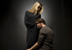 Glamourous blonde lady and her slave. Is down on his knees Stock Photography