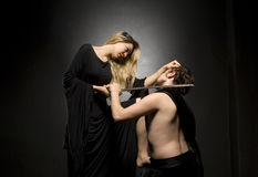 Glamourous blonde lady and her slave. Is down on his knees Stock Image