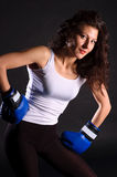Glamourous boxer. Portrait of the glamourous woman boxer isolated on black Royalty Free Stock Photo