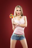 Glamourous girl  holding lollipop Stock Photo