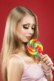 Glamourous girl  holding lollipop Stock Images