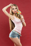 Glamourous girl  holding lollipop Royalty Free Stock Photography
