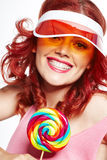 Glamourous girl wearing hat holding lollipop Stock Photography
