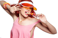 Glamourous girl wearing hat holding lollipop Royalty Free Stock Photography